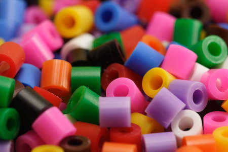 the heterogeneity: Macro of a group of plastic beads of many colors