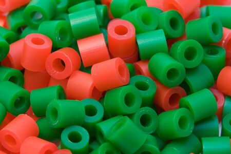red and green plastic beads Фото со стока
