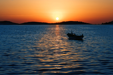 magnificent: Magnificent sunset and anchored boat at sea