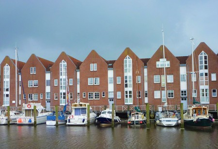 The port of Husum with boats and brick houses