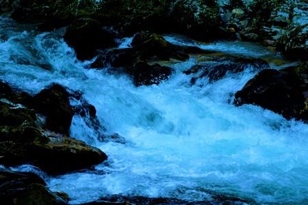 Radovna river rapids and dark rocks in the Vintgar Gorge, Slovenia