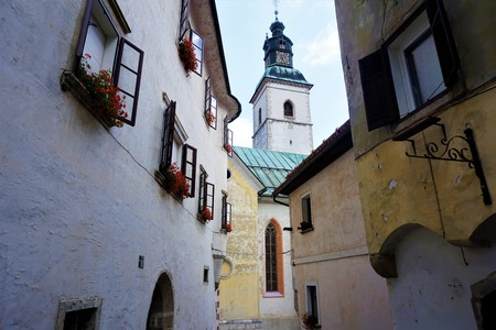 Old houses and church in Slovenian city Skofja Loka