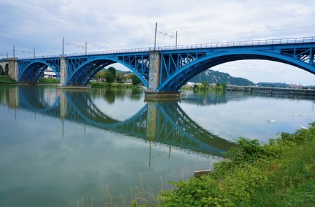 A blue bridge over the Drava river in Maribor, Slovenia