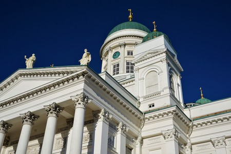 Close-up of Helsinki cathedral with columns in front of a blue sky