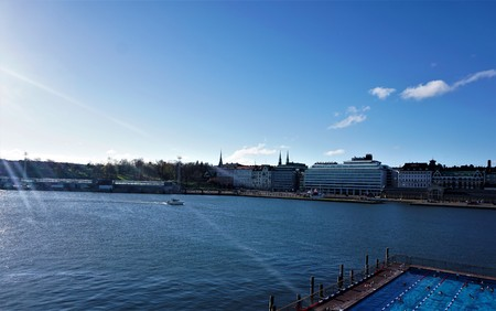 Skyline of Helsinki, Finland with swimming pool and boat