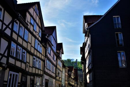 View through street in Hannoversch Muenden, Germany to castle up on the hill