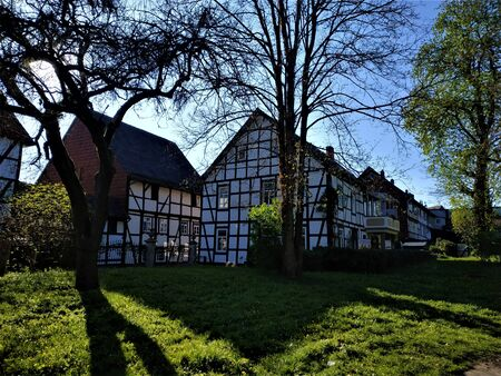 Central park in the city of Einbeck, Germany with half-timbered houses Standard-Bild