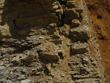 Mostly red sedimentary rock spotted in a limestone quarry