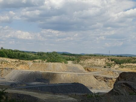 Limestone quarry with roads for the trucks on a sunny day