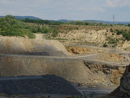 Zooming into limestone quarry with roads for the trucks
