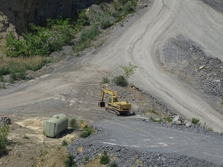 Power shovel spotted in quarry on sunny day