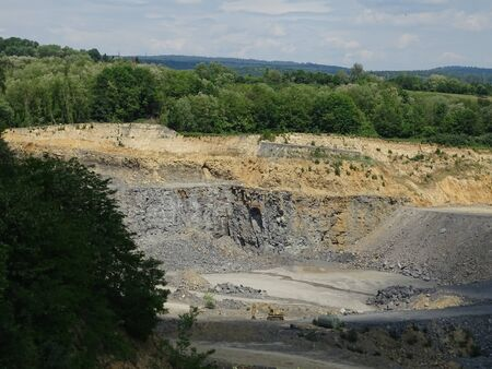 Panoramic view on limestone quarry with resting power shovel Stock Photo
