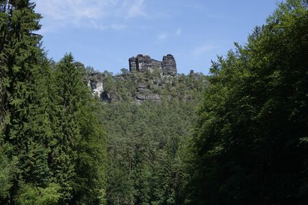 Elbesandstone rock formation spotted from the Amselgrund in Saxon Switzerland, Germany