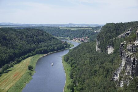 Enlarged view over the Elbe river and the cliffs of Saxon Switzerland to Stadt Wehlen, Germany