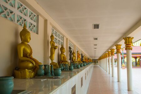 devout: Buddha is a long row of people to worship represents a devout Buddhist Thailand. Stock Photo