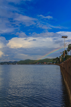 Rainbow formed by the sea in the daytime.