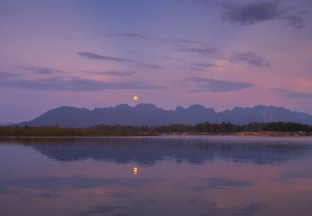 Moon and reflection of the moon at the lake. Banco de Imagens
