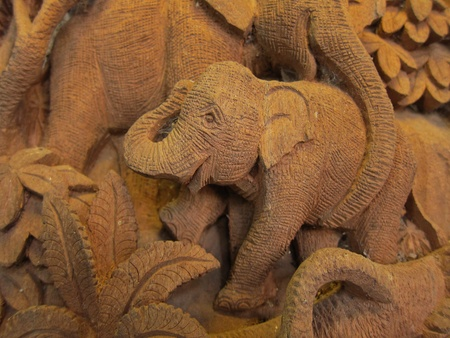 Elephant in Forest High relief Carving and sculpture in thailand  photo