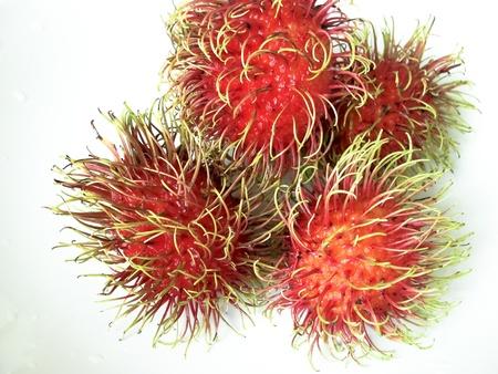 rambutan: Rambutan on dish or plate white color