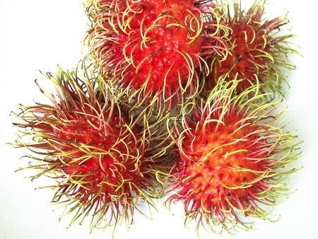 Rambutan on dish or plate white color photo