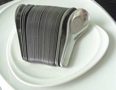 pileup: Silver Spoons on white dish