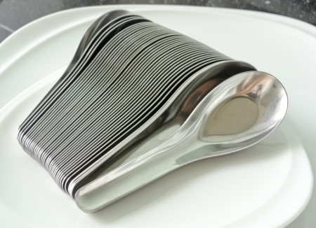 Silver Spoons on white dish Stock Photo - 15122845