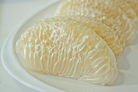 Pomelo citrus on dish plate photo