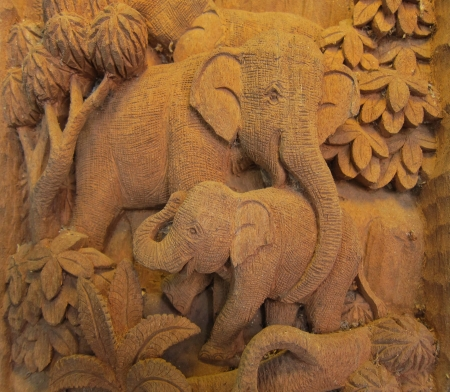 Elephant in Forest High relief Carving and sculpture in thailand Standard-Bild