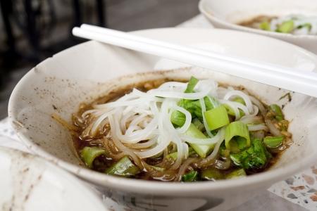 thai noodle soup: bowl of thai style pork noodle soup  lek-nam-tok  thailand  Stock Photo