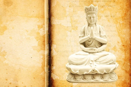 Guan Yin on texture paper background photo