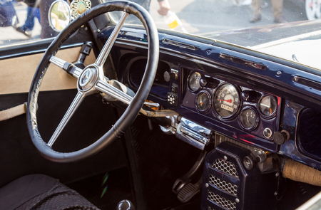 a fragment of the salon of an old retro car. instrument panel of transport. Stock Photo