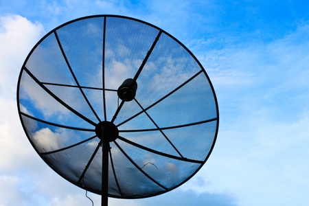 Technology dish receiver on the blue sky. Zdjęcie Seryjne