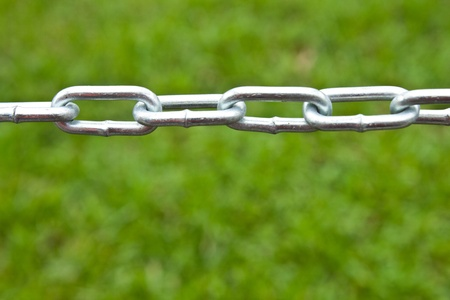 The extent of the barrier chain, green lawn. Stock Photo - 9731820