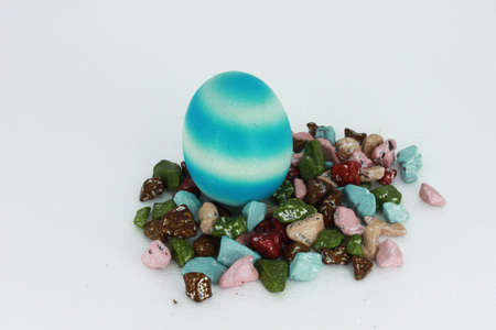 Egg blue and chocolate -colored stones. photo