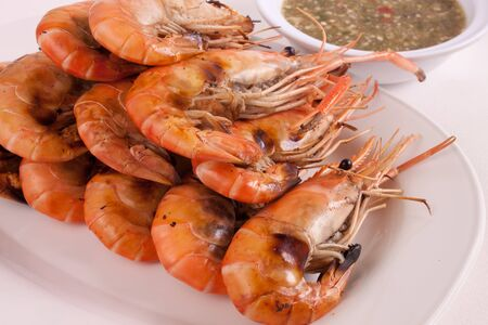 Shrimp, seafood grilled on a white plate photo