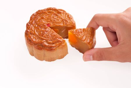 hand and mooncakes on white background photo