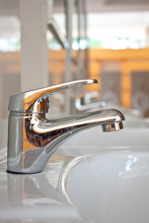 Faucet in toilet for background photo