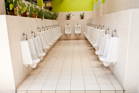 white porcelain urinals in public toilets Stock Photo - 20354131