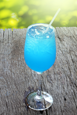 Blue Hawaii cocktail on wooden table