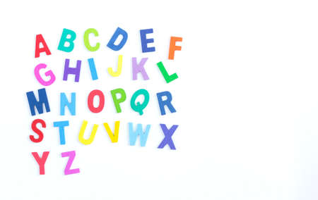 education concept: English alphabet wooden texture colorful on over white background. Business concept. Top View