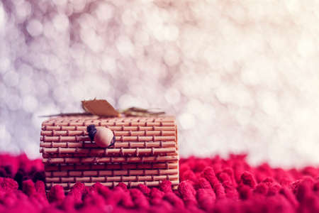 red carpet background: Christmas concept. Gift box bamboo on bokeh background. Vintage warm tone. With space for text your Stock Photo