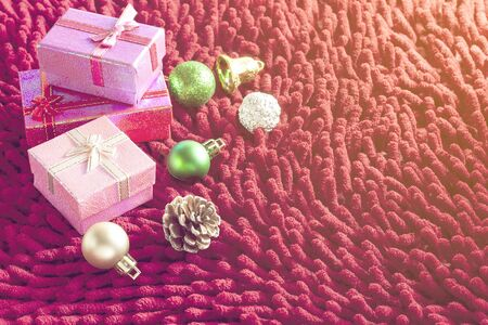 red carpet background: Christmas decorations and gift boxes on the red carpet. Warm tone. With space for text your