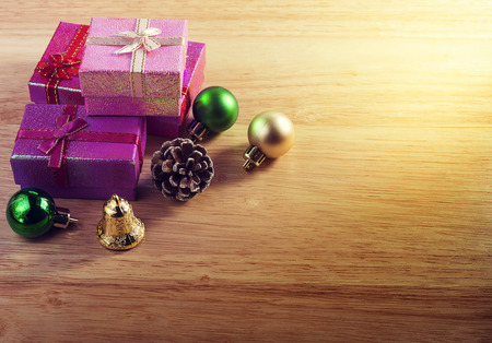 red carpet background: Christmas concept. Gift box and decoration on wooden background. Vintage warm tone. With space for text your Stock Photo