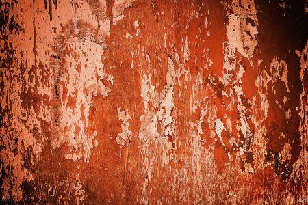 Orange wooden texture background. Peeling paint from plank floor
