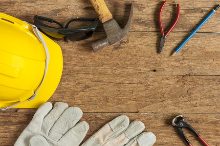 head protection: Helmet and construction tools, Work tool equipment on wooden table. Top view. With for text your