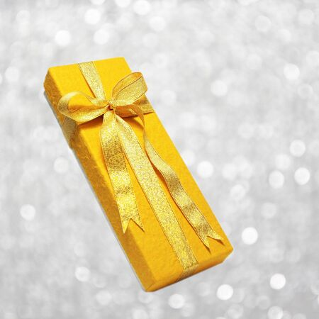 gold gift box on soft background photo