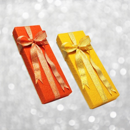 red gift box and gold gift box photo
