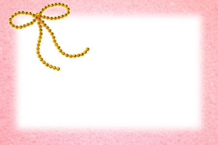 Gold bow on pink frame Stock Photo - 15003231