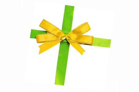 Gold bow on green ribbon Stock Photo - 15255751