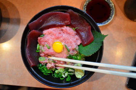 salmon fishery: Bowl of rice topped with tuna